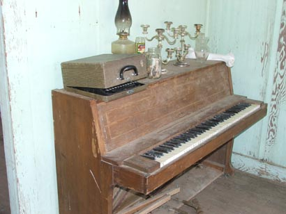 this piano was still there in 2011, although the items on top were missing